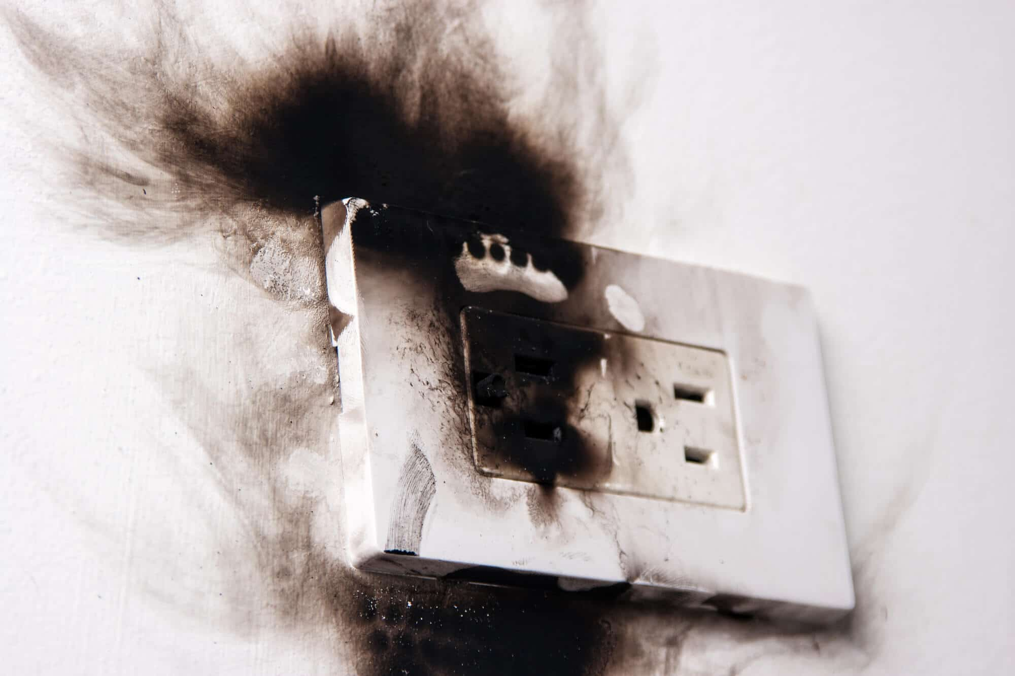 electrical socket with burn marks
