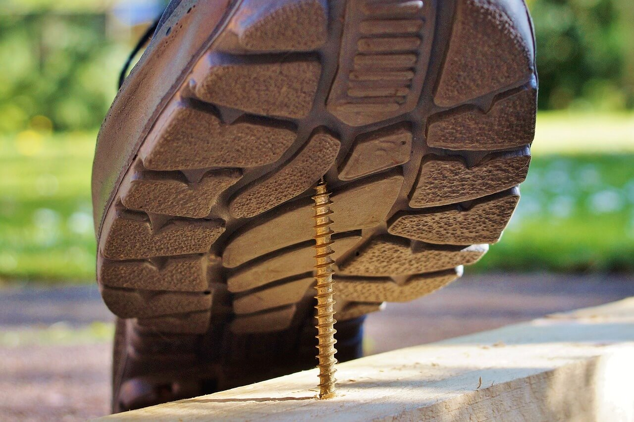 Shoe stepping on a screw