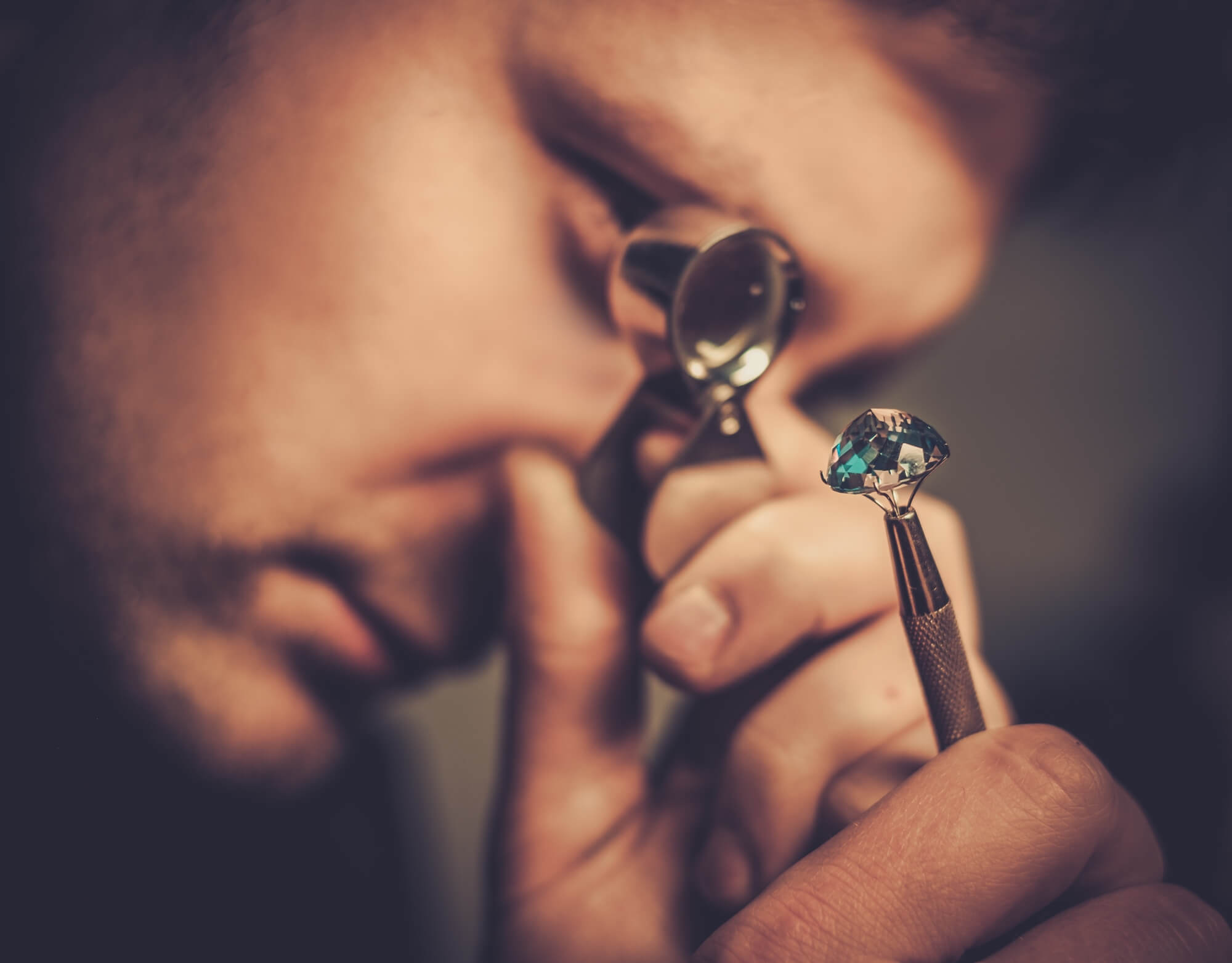 jewelry appraiser examining jewel
