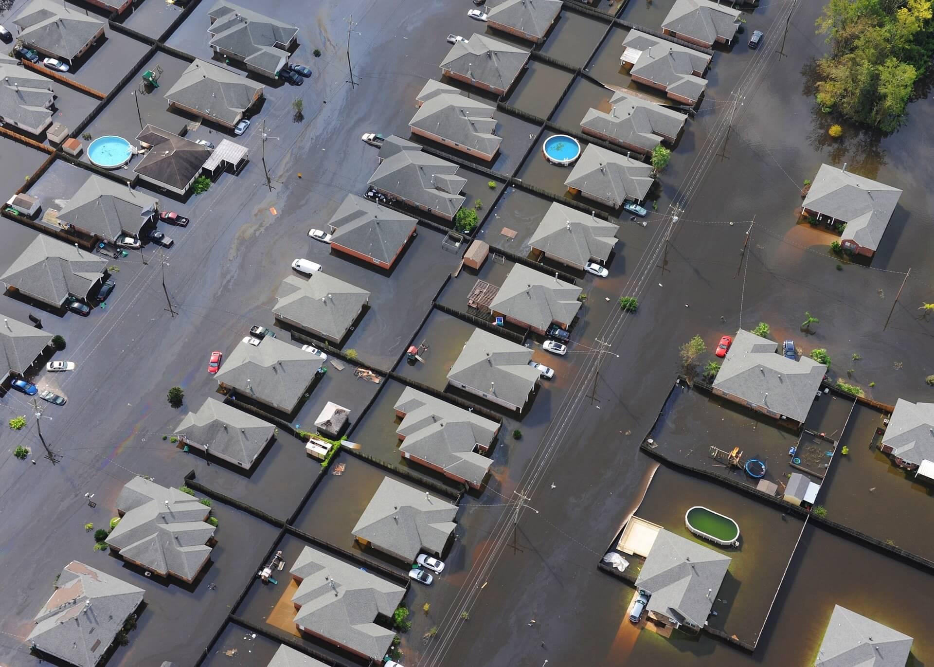 aerial shot of flooded suburban neighborhood