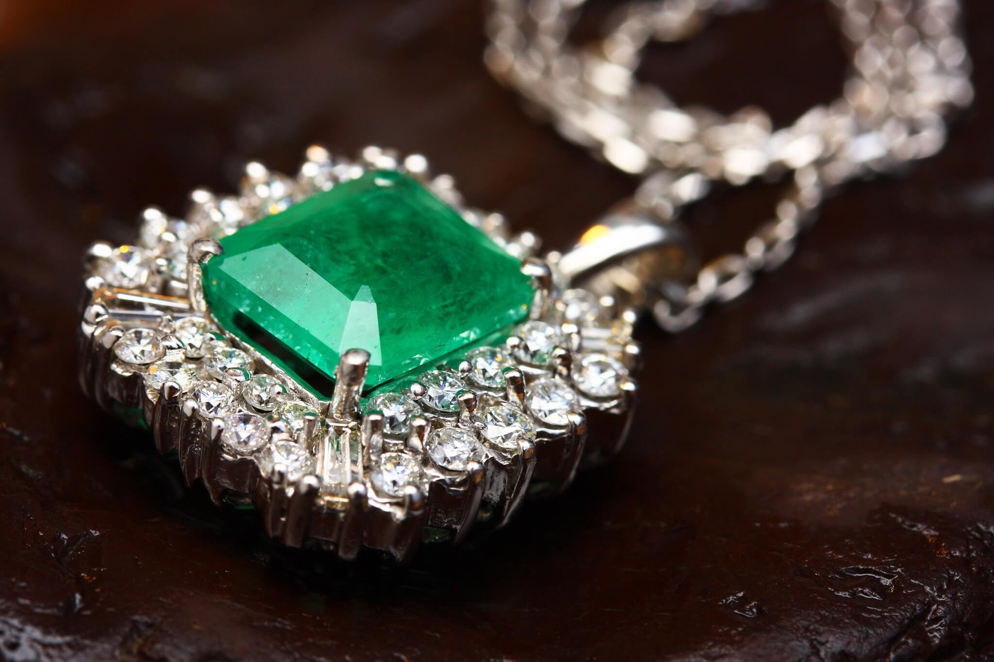 closeup of diamond and emerald necklace