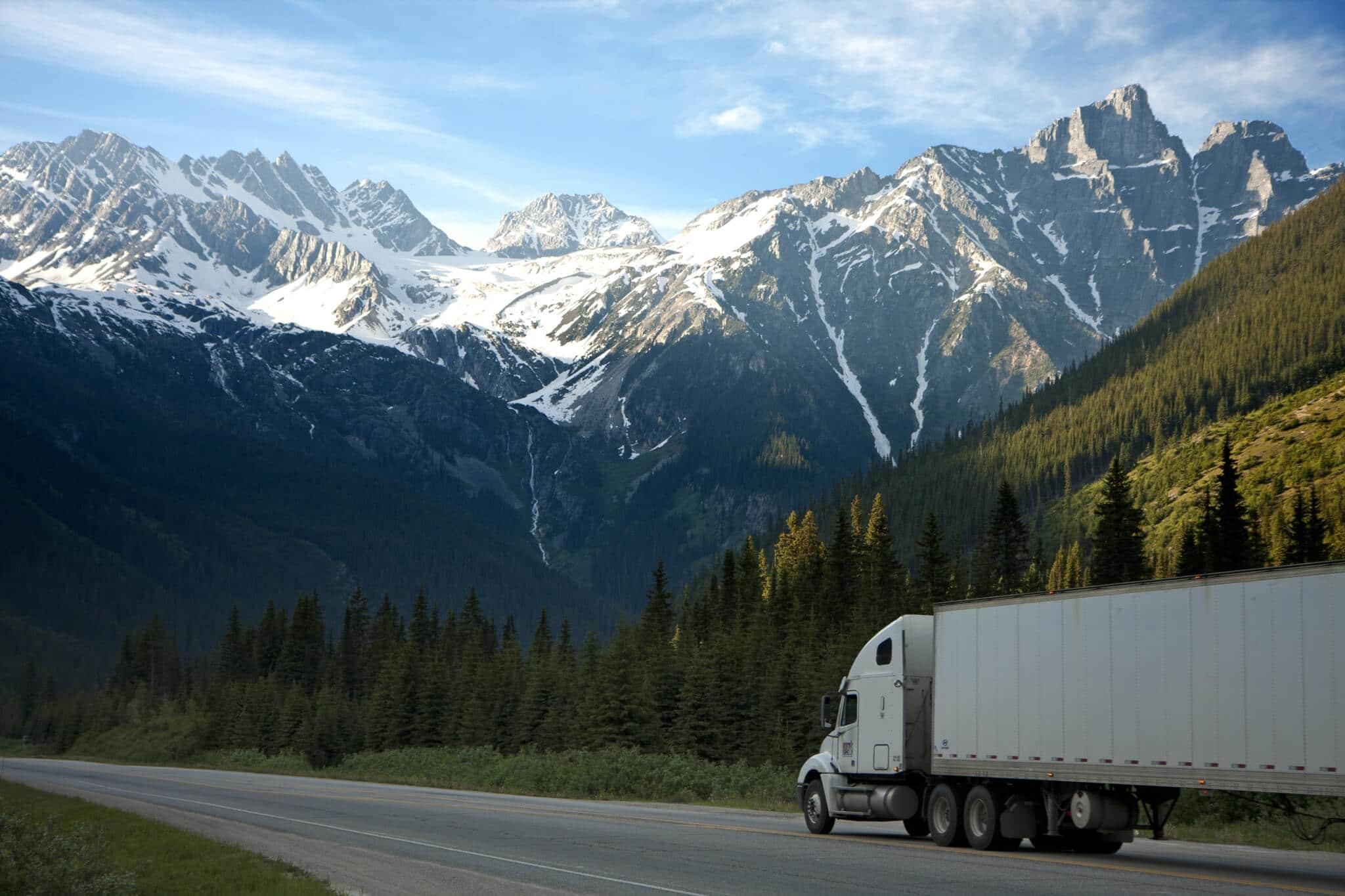 semi truck driving on mountain road