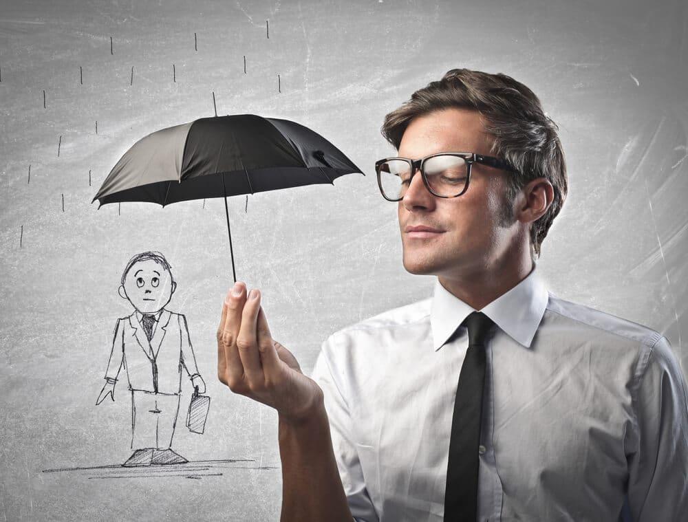 man holding tiny umbrella over cartoon businessman