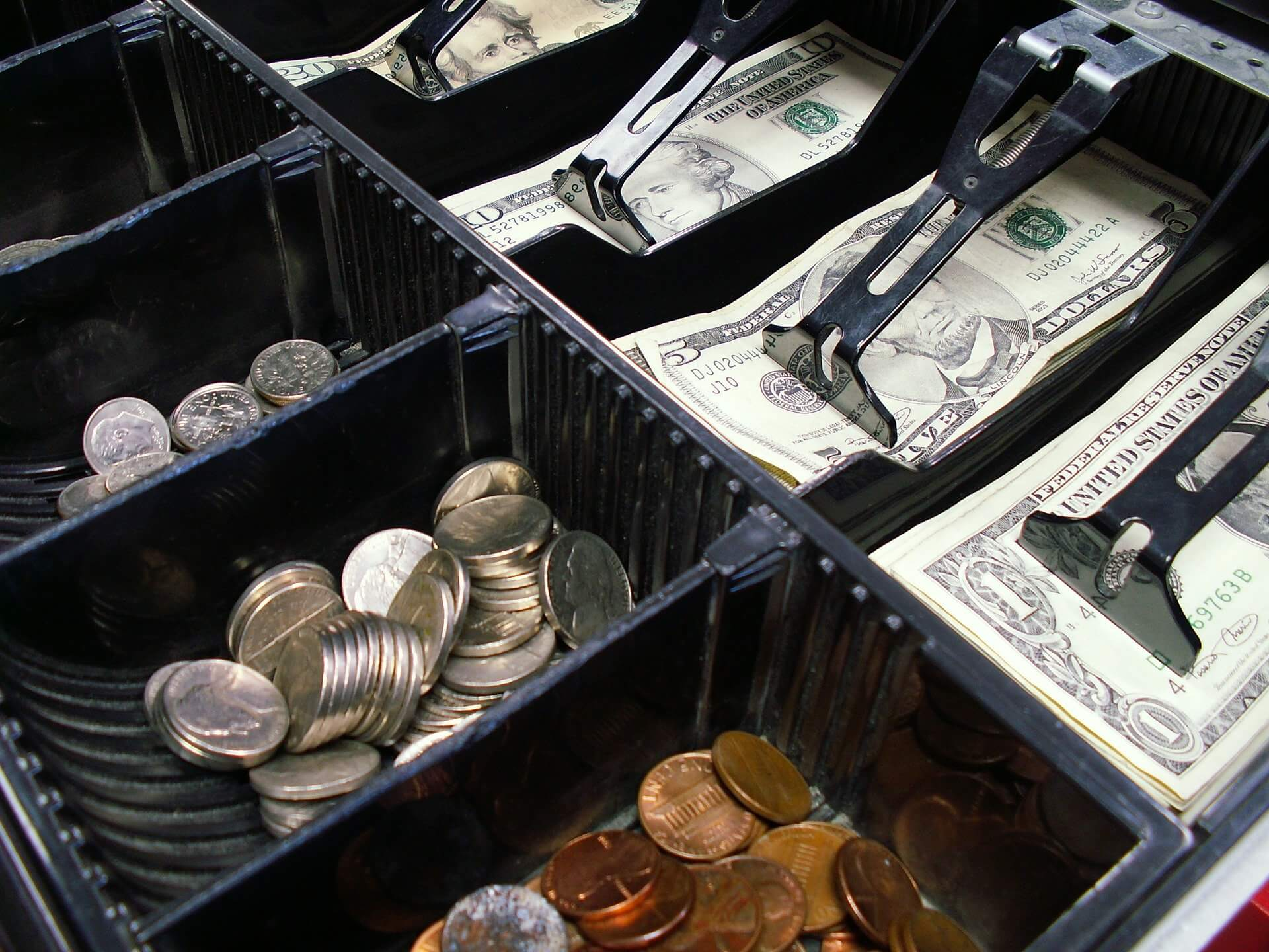 cash register drawer with money