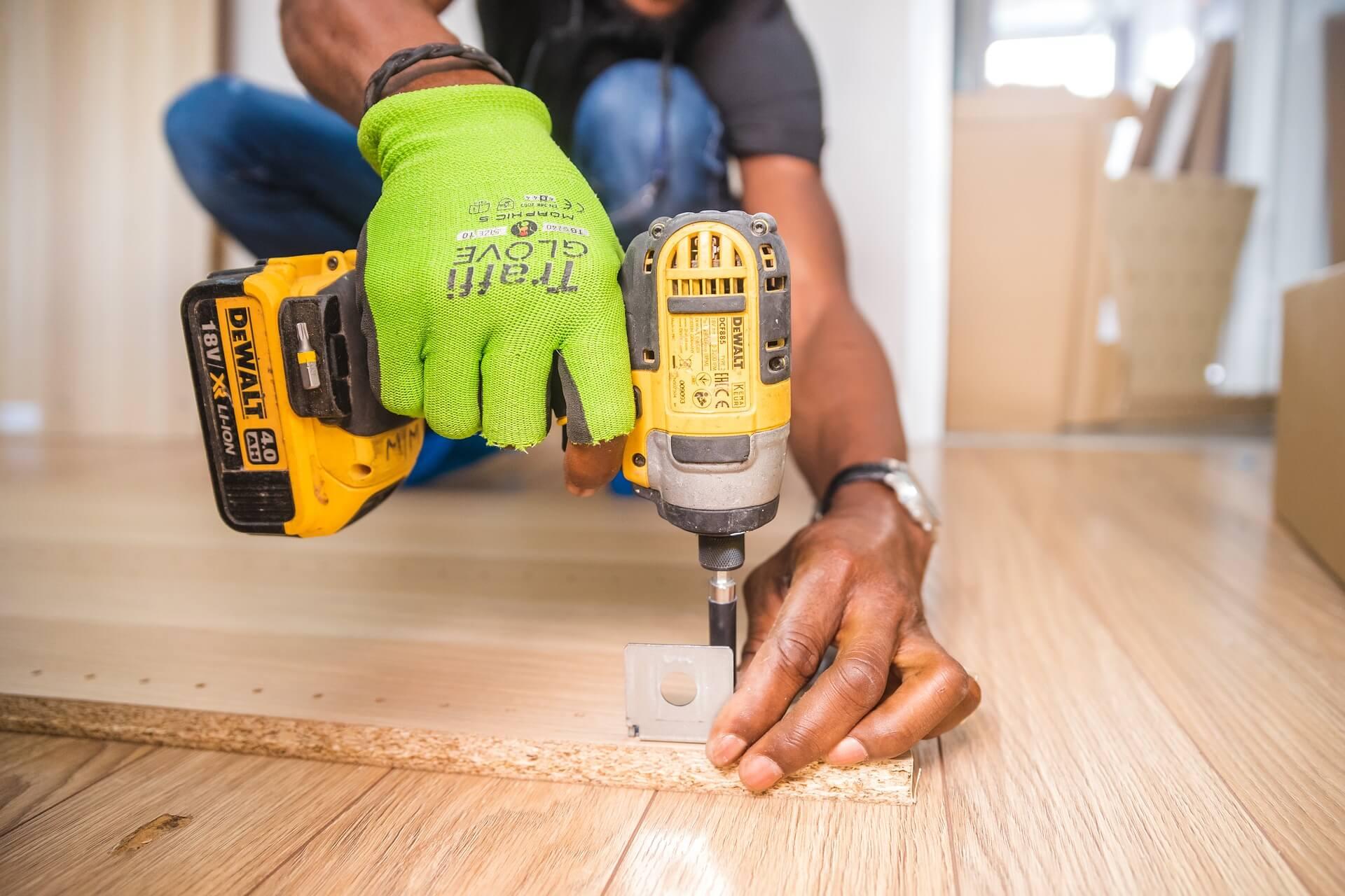 handyman assembling furniture