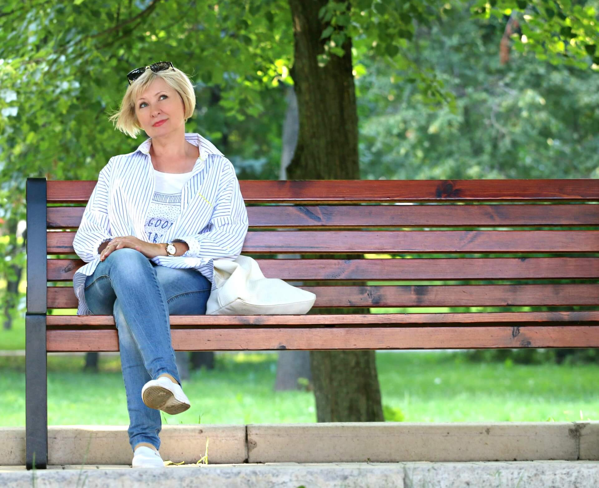 woman thinking on park bench