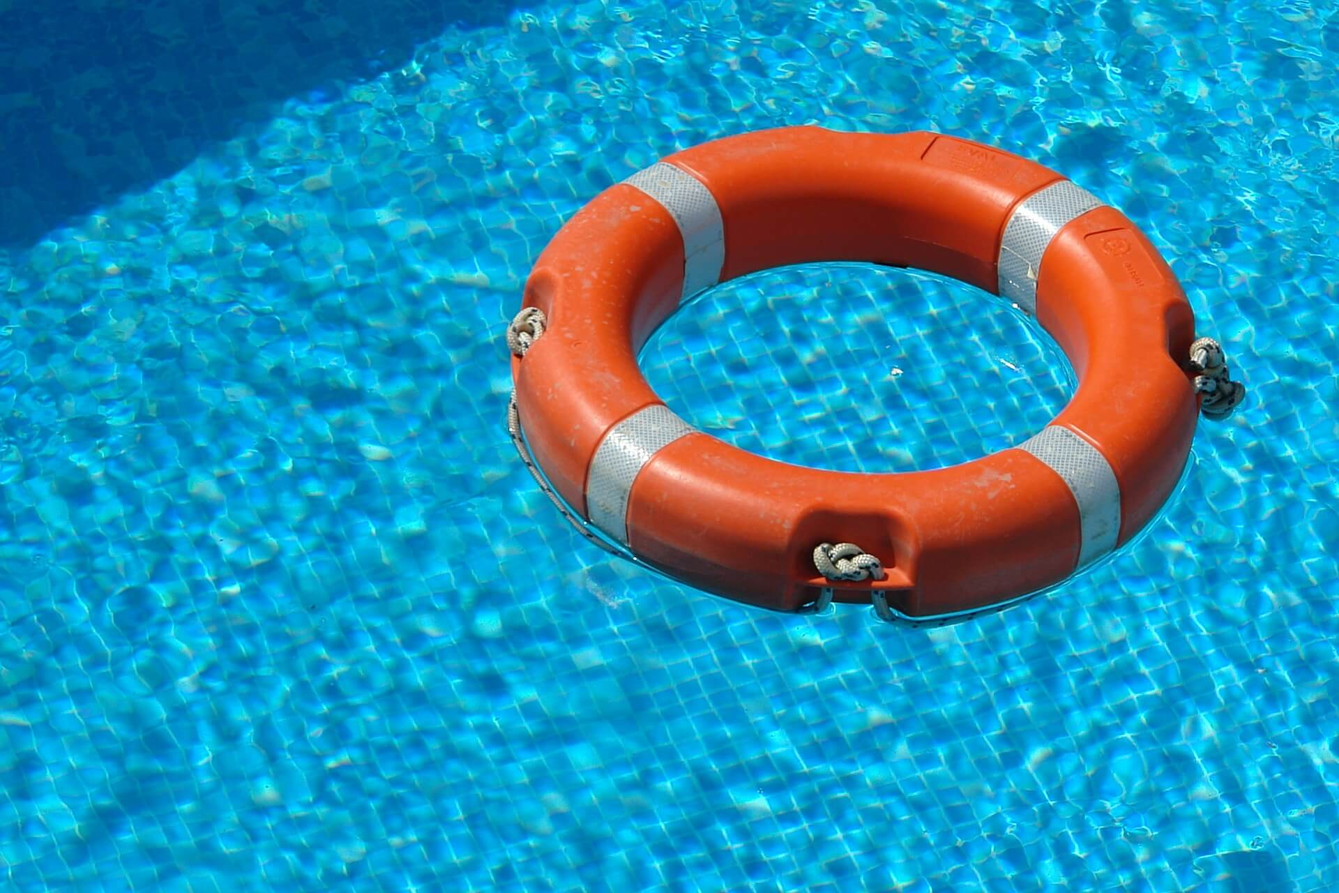 life preserver floating in pool