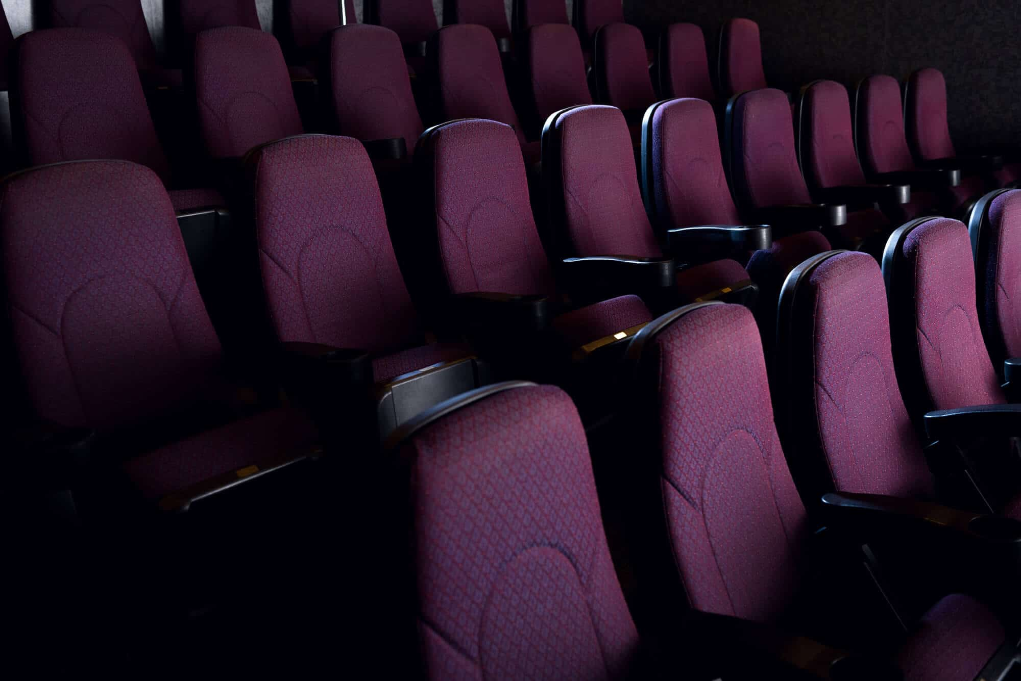 rows of empty movie theater seats