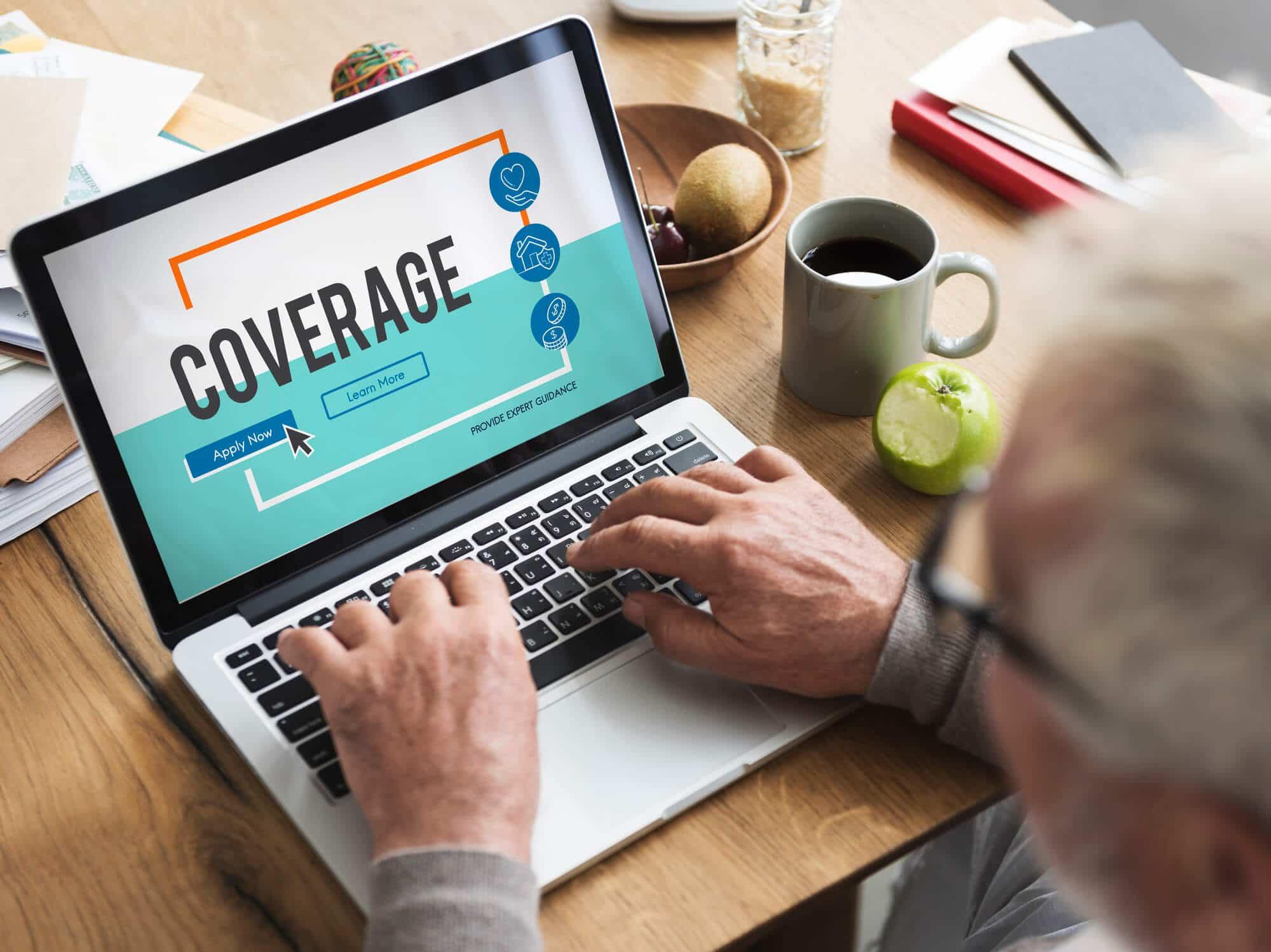Man accessing online insurance portal through laptop